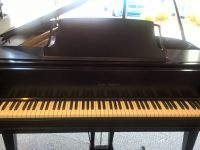 Grand piano is a form of piano which is large in size and whose strings are arranged horizontally. It is played using a keyboard